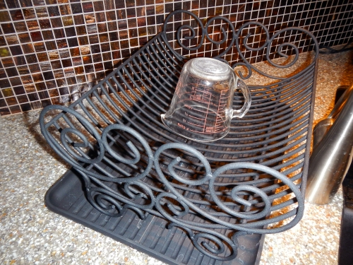 If your dish rack has taken up permanent residence on your counter top, it's possible to find one that is both functional and decorative.